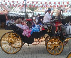 Riding around the Feria de Sevilla in a carriage - every little girl's dream.