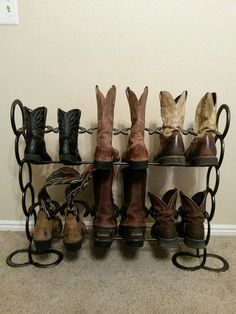 Horseshoe boot rack by HuntingHomeDecor on Etsy, $50.00