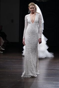 Naeem Khan's long-sleeve lace wedding dress is one of 31 styles we love with extra coverage courtesy of sleeves (and it's sexy thanks to that deep V)