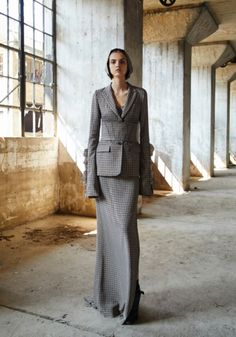 LOOK 23: Beige houndstooth wool blazer with ruffled sleeves. Beige houndstooth wool and silk camisole. Beige houndstooth wool corset with trapunto stitching. Beige houndstooth silk maxi skirt with side slit