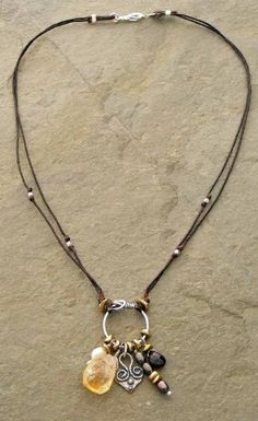 (http://www.elizabethplumbjewelry.com/heart-of-charms-linen-necklace/)