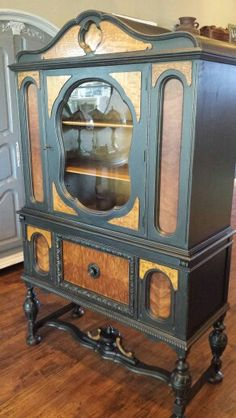 https://www.facebook.com/forallthelittlecouplefans/ 1930's Jacobean China Cabinet finished in Licorice and Natural Burl wood. #ShabbyPaints #PiecesoftimeFF #Licorice