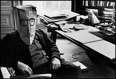 ¤ Steinberg wearing one of his paper-bag masks. From the Mask Series with Saul Steinberg, 1959. Photograph by Inge Morath © The Inge Morath Foundation/MAGNUM PHOTOS.