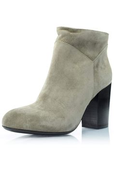 "This bootie is the perfect slide on bootie for the fall. Best paired with your favorite dark jeans or fall dress, these boots are sure to be your go-to shoe. Details: A taupe suede slide-on bootie, 3.25 inch chunky heel, elastic stretch, wide fit on ankle is intended.    Heel height: 3.25""    Taupe Suede Bootie by Fabio Rusconi. Shoes - Booties - Heeled South Carolina"