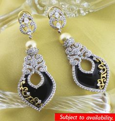 PARTY LOOK #MySiaLook  Marvellous American Diamonds with enamelling put together in a fantabulous Earrings with a touch of glamour & style from Arte Sia. Arte Sia - a brand for luxurious jewellery has come up with a very unique range of products. Go ahead & make a style statement. Buy it from http://siajewellery.com/ProductDetails.aspx?Cat=ArteSIA%20Collection=0=1503=91 & Sia Art Jewellery Stores