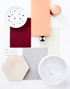 OK omin käsin -book, ox blood, salmon, concrete, carerra marble, white and black