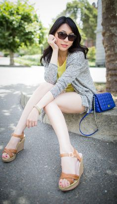 Healthy Summer Look - yellow chiffon blouse/white x black shorts/wedges/gray cardigan/blue bag/long pearl necklace