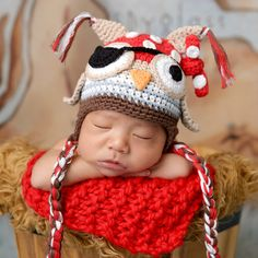 $18.99 This Pirate Patch Owl Baby Boys Hat from Melondipity is a super cute hat for your little boy! This hat combines our beloved baby owl and a very popular pirate theme! This is an OWL PIRATE! This hat is beautifully crafted with a lot of design detail! This hat 100% cotton crocheted hat is made from tan, brown, white, light blue, red, black and orange yarn. I found this on www.melondipity.com