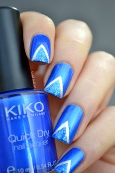Bright blue tape mani with blue glitter and silver detail