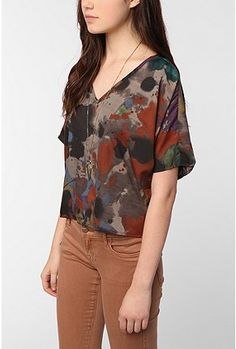 this Earth tone colored shirt will look good on someone with an autumn skin tone.