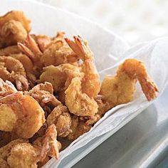 For these Cajun-flavored fried shrimp, peel the shrimp but leave the tails on and coat the shrimp in fish fry mix to get a crispy brown coating.