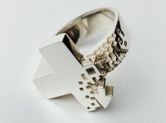 Pixel Plus Ring 3d printed Jewelry Rings The pixelated effect is intended to showcase the emersion of voxels, a unit of measure