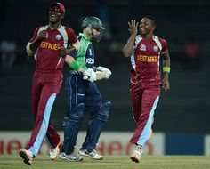 West Indies, Fidel Edwards and Darren Sammy, celebrate after Ireland's, William Porterfield's, wicket. #T20 #Twenty20