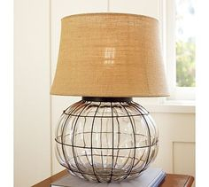 table lamp with metal fretwork and a burlap shade