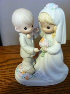 Precious Moments Cake topper. We could darken the hair :)