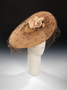 Hat  Sally Victor  (American, 1905–1977)    Date:      1935  Culture:      American  Medium:      straw, linen, silk  Dimensions:      4 1/2 x 16 1/2 in. (11.4 x 41.9 cm)  Credit Line:      Brooklyn Museum Costume Collection at The Metropolitan Museum of Art, Gift of the Brooklyn Museum, 2009; Gift of Sally Victor, Inc., 1944