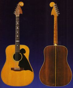 """Merle Travis's Bigsby-renecked Martin D-28 (Travis played this instrument in the recording sessions for 1972's """"Will the Circle be Unbroken""""). He liked the playability of the Bigsby neck on his electric so much that he commissioned Bigsby to replace the neck on his Martin.  Note the """"suits of cards"""" fretboard markers like the ones on the 948 electric (The Bigsby Files)"""