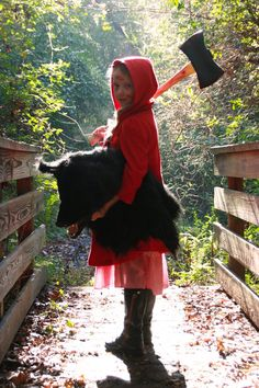 Little Red Riding Hood Strikes Back - she's taking charge on her own!  When my daughter gets a little older and starts to become warped like the rest of our family..... I am going to have to remember to try to do something like this with her for Halloween.