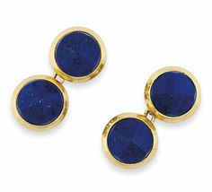 A PAIR OF LAPIS LAZULI CUFFLINKS, BY CARTIER  Each circular panel with faceted lapis lazuli centre within a bevelled collet setting, to chain-link connections, French marks for gold Signed Cartier and no.09663