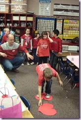 Classroom Party Games: Crossing the melted river of chocolate race: you have two hearts…and you have to cross the room only by stepping one them! this would take two minutes to cut out the hearts! great last minute game!