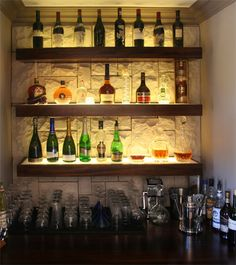cool liquor display with stone wall background