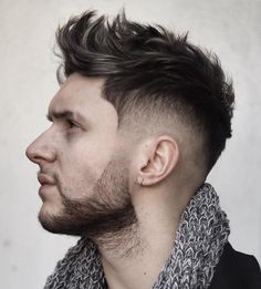 The faux hawk haircut, also known as the fohawk, is a men's hairstyle trend with a lengthy reign as a popular men's haircut. That's because this hairstyle is easy to style, can work at any length and with a