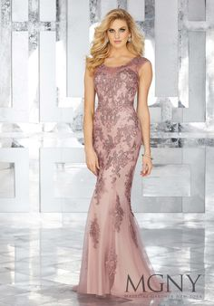 MGNY   Madeline Gardner, Evening Dress style 71632. Pink Form Fitting Special Occasion Gown Featuring Embroidered Lace Appliques and Sparkly Beaded Details. Crystal Beaded Classic Neckline with Illusion Elements. Available: Mocha Pink, Charcoal Grey. Perfect for any Formal event including a Military Ball and Mother of the Bride.