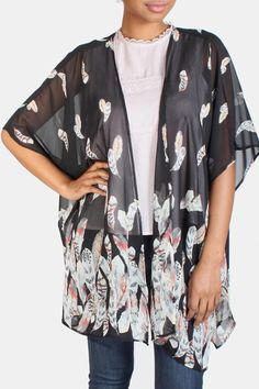 This sheer lightweight kimono is the perfect layering piece for those warmer months! Featuring wide three-quarter sleeves and beautiful feather print detailing. Available in ivory and black. Feather Print Kimono by Jella Couture. Clothing - Jackets Coats & Blazers - Kimonos & Wraps California