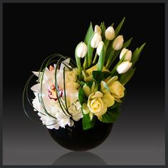 Two white hydrangea, ten white tulips, three kale stems, two white cymbidium orchids, and bear grass in a black round vase W x 7 H). Contemporary Flower Arrangements, Fall Floral Arrangements, Vase Arrangements, Art Floral, Floral Design, Ikebana, Flower Centerpieces, Flower Decorations, Hotel Flowers