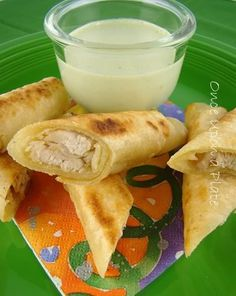 Chicken Taquitos made with White Corn Tortillas, not deep fried. Served with Cilantro Cream Dipping Sauce