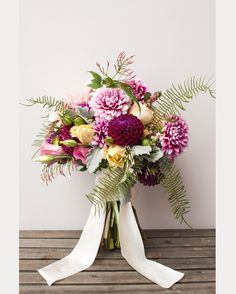 We are partial to dahlias and this flower recipe by Violet and Verde has our heart racing.  With the dark purple and bi-color dahlias mixed with ranunculus, caramel antike roses, ferns and dusty miller, etc, this beauty would be perfect for any summer bride!  Have a look ~ Photography by Charlie Juliet