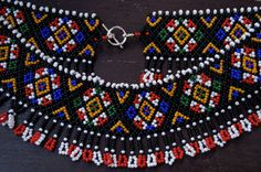 Necklace made of glass beads Toho 11/0 Netting stitch.  Lenght 42 cm, width 5 cm.  The pattern characteristic of the Carpathian region.  For more information visit: www.facebook.com/ArtFromKryg
