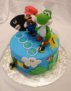 This 9th Birthday Cake with a Super Mario Bros theme was delivered to Manhattan this past weekend. The Mario and Yoshi on this cake are toys. It was a rush last minute order so hand molding was out of the question. Alex was the Birthday Boy's Name. T Cake Decorating