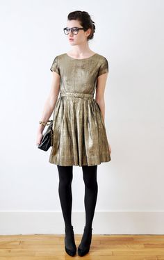 gold dress, black tights