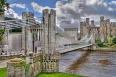 Conwy Suspension Bridge, over the River Conwy, Conwy, Wales (1826) one of the first road suspension bridges in the world. Built by Thomas Telford, who matched the bridge's supporting towers with the castle's turrets