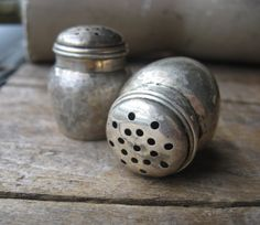 Tiny sterling salt pepper shakers