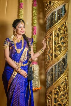 South Indian bride. Gold Indian bridal jewelry.Temple jewelry. Jhumkis.Purple silk kanchipuram sari.Side braid with fresh jasmine flowers. Tamil bride. Telugu bride. Kannada bride. Hindu bride. Malayalee bride.Kerala bride.South Indian wedding.