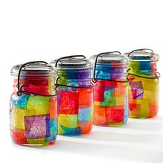 Aren't these colorful jars cute? Make the most of your old pasta and jam jars by letting little kids go wild with tissue paper and glue (or Mod Podge). Once dry, fill them with craft supplies or a candle!  Source: Etsy user usedandabused