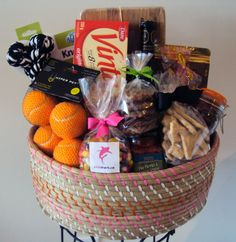 pinkshark.ca created this basket for a young couple (and their pup) who are moving into their 1st home!    The fabulous items included in this basket are: a bamboo serving board, Okanagan Pinot Noir wine, bruschetta & crackers, BC smoked salmon, oatmeal raisin cookies, gourmet spiced nuts, jelly beans, almond cranberry cookies and some fun and tasty dog treats and toys! The woven basket itself will look great used anywhere in their new home. $100    Follow us on Facebook, Twitter & on…