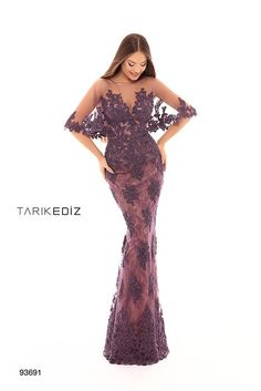 This lilac lace gown by TARIK EDIZ has an an illusion neckline and bat sleeves. The floor-skimming dress is subtle and elegant so it's perfect for any formal event. African Dress, Indian Dresses, Formal Gowns, Strapless Dress Formal, Affordable Prom Dresses, Couture, Dress Collection, Pretty Dresses, Bridal Dresses