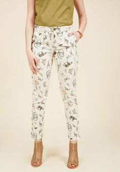 <p>Prowling around for an ensemble so epic it'll be remembered aeons from its debut? These ivory trousers from our ModCloth namesake label should do the trick! Made from stretch-cotton twill, these pocketed bottoms are printed with animals aplenty, polishing off your look with simple, yet storied panache!</p>