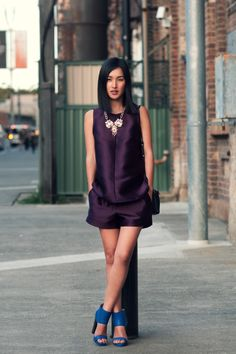 Nicole Warne. Scanlan and Theodore top and shorts, Anton Heunis necklace, Aila clutch, and Tom Gunn shoes. Citizen Couture.