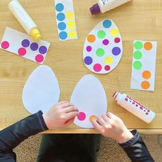 Cut egg shapes from paper, and set out with dot stickers (or dot markers)