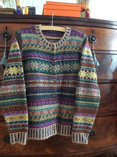 Knit this women's fairisle cardigan from Rowan Knitting & Crochet Magazine 52, a design by Marie Wallin using the beautiful yarn Felted Tweed (merino wool and alpaca). With set-in sleeves, round neck and striped rib and cuffs, this knitting pattern is for the experienced knitter.