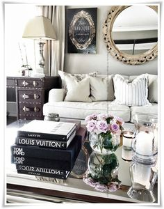 For the sitting area -  mirrored table, comfy chair, roses, and fashion books