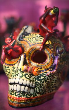 sugar skull. Sugar skulls represented a departed soul, had the name written on the forehead and was placed on the home ofrenda or gravestone to honor the return of a particular spirit