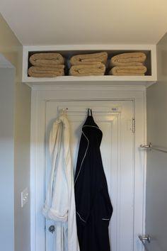Tutorial: A storage box above the door  http://the2seasons.com/2012/11/12/bathroom-storage-just-like-marthas/