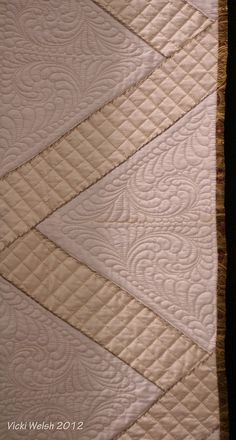 Quilting by Vicki Welsh  Crosshatch & feather quilting in triangles. Cool Feather design
