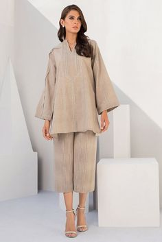 Karandi kurta with lace detailing for the win. Pair it up with our signature Karandi culottes with lace detailing to complete the look. *Karandi culottes with lace detailing to be sold separately. Pakistani Fashion Casual, Pakistani Dresses Casual, Pakistani Dress Design, Muslim Fashion, Ethnic Fashion, Elegant Dresses Classy, Classy Dress, Indian Designer Outfits, Indian Outfits