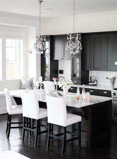 kitchen with a pair of beaded crystal chandeliers above large kitchen island - www.insterior.com